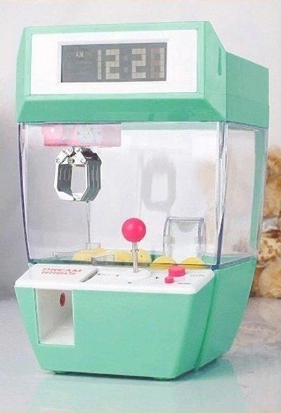 【訊息分享附圖5】淘寶 夾娃娃趣味造型鬧鐘.jpg